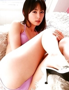 Rina Akiyama with sexy legs looks hot in mauve bath suit