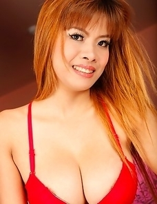 Thai MILF with huge tits